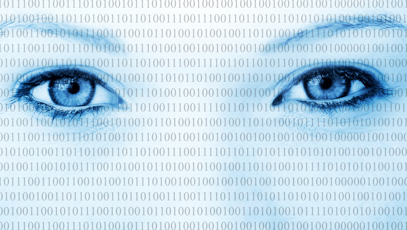 Eyes of a woman with binary code running across her face